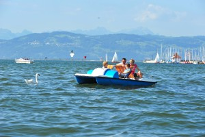 Pedal boat on Lake Constance at Lindau town