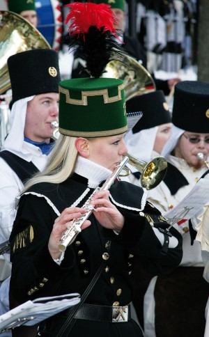 Flute players in traditional uniforms at a parade in the Erzgebirge mountains
