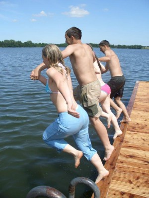 Jumping from the jetty into the lake