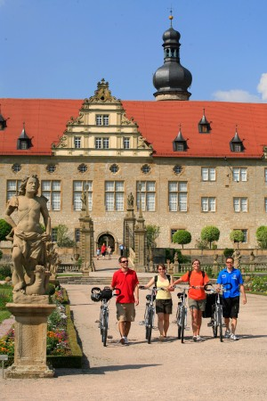 Cyclists in front of Weikersheim Palace