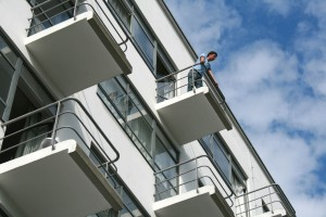 Visitor on the balcony of the studio building (Prellerhaus), Bauhaus buildings, Dessau