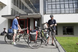 Cyclists in front of the Bauhaus building, Dessau